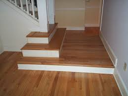 the red oak spiral staircase was carpeted three times we stripped the carpet padding tackstrip nails and staples then we pletely sanded and