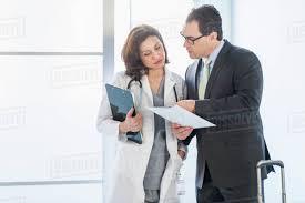 Pharmaceutical Representative Pharmaceutical Representative Talking To Female Doctor Stock Photo