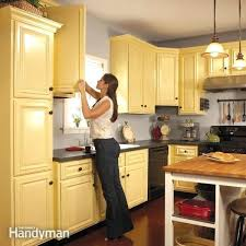 professional kitchen cabinet painting how to spray paint kitchen cabinets professional kitchen cupboard painters