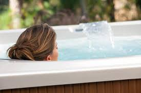 a woman soaks in her hot tub before or after exercise for good health