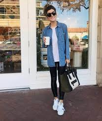 leather leggings outfit with denim chambray shirt and sneakers