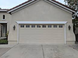 the first step to this garage conversion was removing the old door and the garage door opener