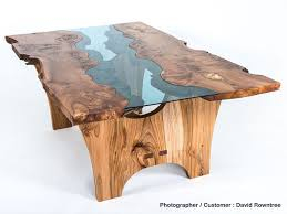 image of a glass river table produced using blue tinted glass
