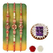 Order Set of 3 Swastik Rakhi with Burfi with Silk Online at Rs. 2529/– Same  Day Delivery