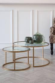 2 circular glass brass coffee tables