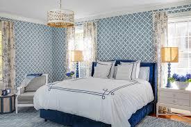 gold drum light over blue velvet bed
