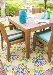 i recommend going a little bolder with your outdoor rugs than you would indoors the more color and pattern the better i loved the bright blue and green