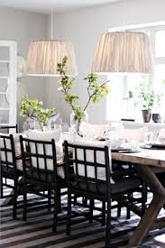 fantastic monochromatic dining e with weathered x base table striped rug a pair of