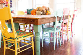 love the colors the diffe chairs the rustic table top the light in the room and everything else