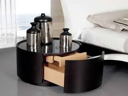elegant dark wooden round small bedside tables with trundle drawer and black gloss finish