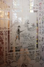antique door with figural etched glass hunting scene with man dogs c