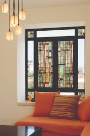 shis window with elegant artscape window film in stripped motif matched on  beige wall plus pendant