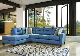 navy blue sectional image of leather sofa with white piping