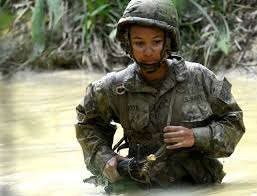 u s department of defense photo essay u s navy seaman dominque brown wades though a muddy creek just ahead of her squad on