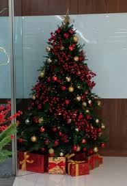 A Christmas tree with red decorations
