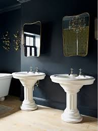 black and gold toilet. (image credit: godrich interiors). a black bathroom with white and gold accents from toilet d