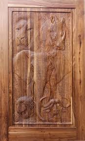 van acht african art pivot doors