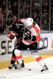 Andreas Nodl of the Philadelpia Flyers battles for the puck with Erik...  News Photo - Getty Images