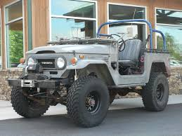 I like this old Toyota Land Cruiser FJ40. Makes me want to get ...