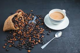 Cup of coffee with coffee beans on a dark background 1979282 Stock Photo