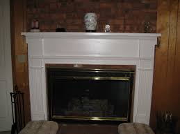 traditional wooden fireplace mantel