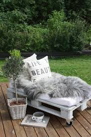 12 put together a cushion and some pillows on top of a painted wood pallet and you get a very comfy bed 22 easy and fun diy outdoor furniture ideas