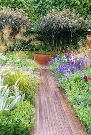 photo 8 of garden path made wood leading to water feature lined with flowers and wooden wooden garden path