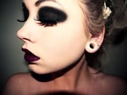 gothic heavy black eye makeup and deep purple lips