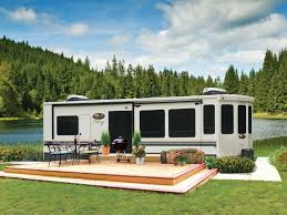forest river cedar creek cote 40cl rv with deck next to a river