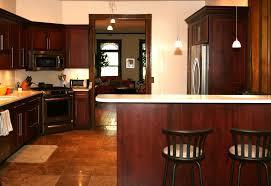 cherry kitchen cabinets with white trim