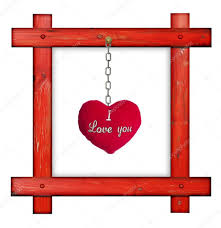 old wooden red frame against a white background with red soft heart with sign i love
