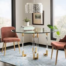 round dining table on top of a rectangular area rug