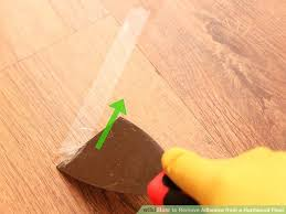 removing adhesive from wood floors image titled remove adhesive from a hardwood floor step removing tile