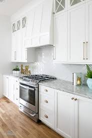 modern cabinet pulls white shaker. A Stainless Steel Oven Range Sits Against White Herringbone Backsplash Tiles Beneath Paneled Hood Flanked By Shaker Cabinets Adorning Modern Cabinet Pulls U