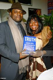 Carl Ford and author Susan Batson pose for photos during Susan... News  Photo - Getty Images