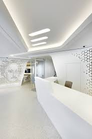 office define. great lines to define the space ceiling and reception mimic each other with office