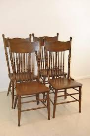 set of 4 antique spindle back dining room chairs with pressed dragon detail