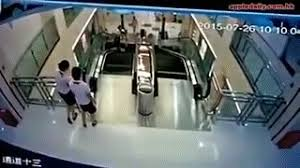 escalator fall gif. tragic accident in china! woman killed on escalator, but managed to save her child make a gif escalator fall gif