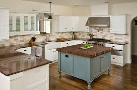 countertops for white cabinets. These Stunning Wood Floors Are Complemented By The Island Countertop And Chocolate Brown Granite Inside Countertops For White Cabinets