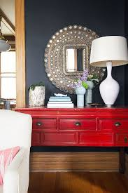 red hallway table. there goes my dream mirror again and above a red chinese console table! peacock you will be mine someday. hallway table e
