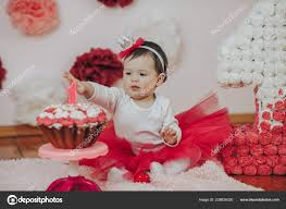 Curious Baby Girl Poking Finger In His First Birthday Cake Stock
