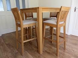 tall oak breakfast table and 4x java soild oak bar stools in cream linen material