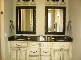 bathroom ideas cream wall paint mirror with wooden carving frame black granite countertop mounted washbasin storage