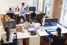 small business office design. wide angle view of busy design office with workers at desks small business