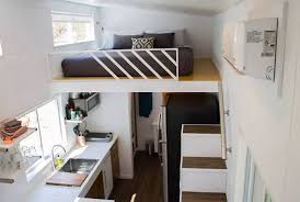 Small Picture River Resort is a modern double loft tiny house with two