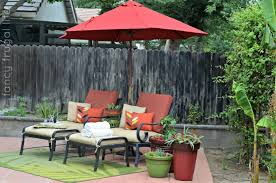 backyard with outdoor patio and patio furniture also sunbrella umbrella with outdoor rug