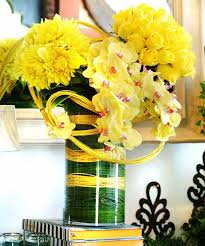 creative centerpieces with flowers in yellow color that include orchids are  exotic centerpiece ideas