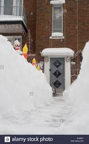 a path to a duplex s front door from a snow bound montreal suburban street after a