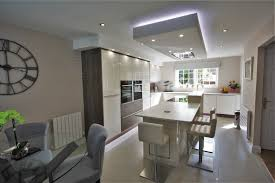 kitchen design chelmsford. essex acrylic gloss slab door mixed with old american panels - modern kitchen design chelmsford b