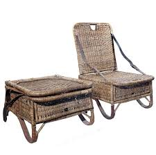 pair of folding wicker canoe chairs for